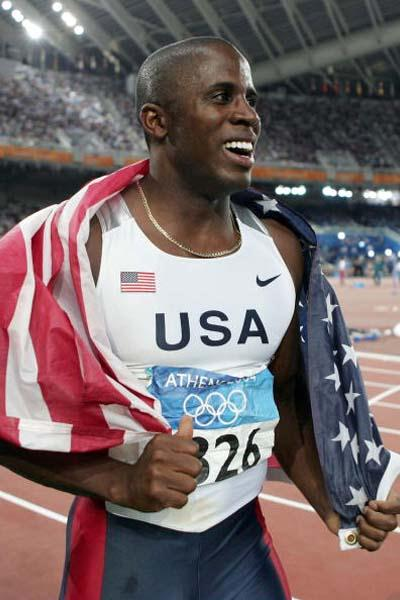 Dwight Phillips of the US celebrates winning the Long Jump final (Getty Images)
