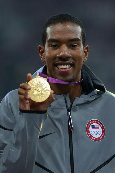 Gold medalist Christian Taylor of the United States celebrates on the podium during the medal ceremony for the Men's Triple Jump on Day 13 of the London 2012 Olympic Games on 10 August 2012 (Getty Images)