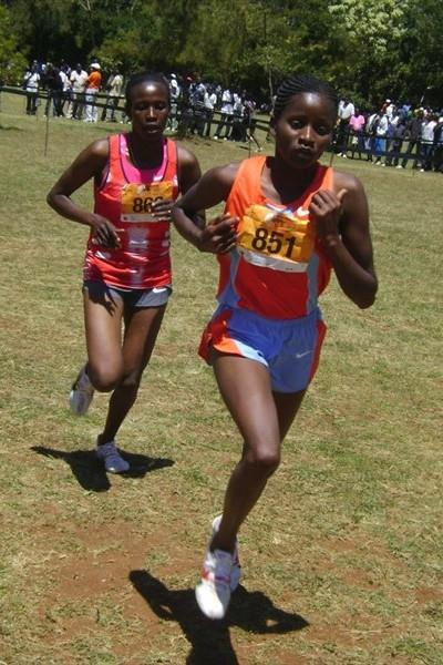 Gladys Chemweno (851) leads Pamela Lisoreng in the senior women 8km race during the 19th edition of the Discovery Cross country. (David Macharia)