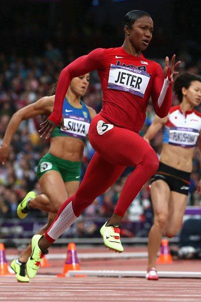 Carmelita Jeter of the United States runs in the Women's 200m heat on Day 10 of the London 2012 Olympic Games at the Olympic Stadium on August 6, 2012 (Getty Images)