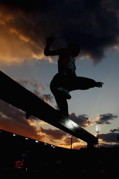 Ruth Bisibori Nyangau negotiates the water jump en route to winning the women's steeplechase (Getty Images)