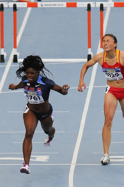 Morgan Snow of United States celebrates running for Gold Medal ahead of  Dou Wang of China during the Women's 100 metres hurdles Final on day six of the 14th IAAF World Junior Championships in Barcelona on 15 July 2012 (Getty Images)