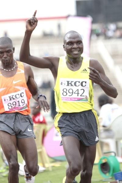 Vincent Chepkok (right) celebrates winning the 5,000m as Joseph Ebuya (left) trails him in the New KCC National Trials for the 2009 World Championships in Athletics at the Nyayo National Stadium in Nairobi (Elias Makori)