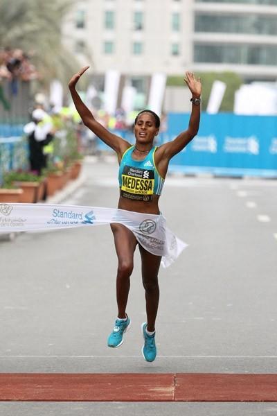 Aselefech Mergia of Ethiopia winning the 2011 edition of the Dubai Marathon (Victah Sailer)