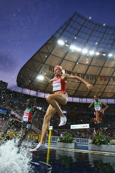 Spain's Marta Dominguez clears the water jump in the women's 3000m Steeplechase final (Getty Images)
