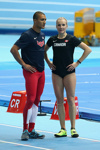 Brianne Theisen-Eaton talks to husband Ashton Eaton in between events at the 2014 IAAF World Indoor Championships in Sopot (Getty Images)