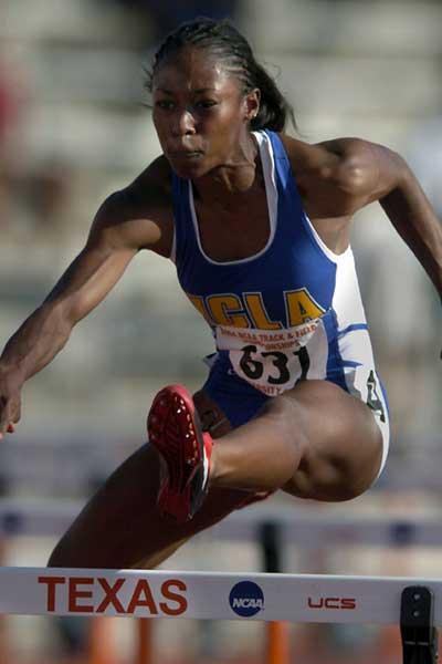 Sheena Johnson  on her way to winning the women's 400-metre hurdles (Kirby Lee)