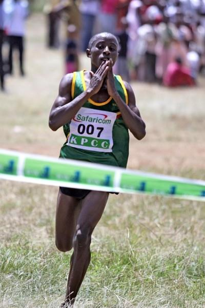 John Mwangangi celebrates as he crosses the finish line to win the 12km race at the Kenya Prisons Cross Country Championships at Ruiru, Saturday (MOHAMMED AMIN/ DAILY NATION)