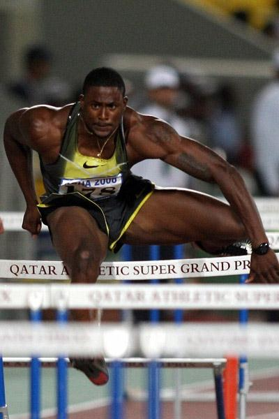 David Oliver en route to his 12.95 victory in Doha (AFP/Getty Images)
