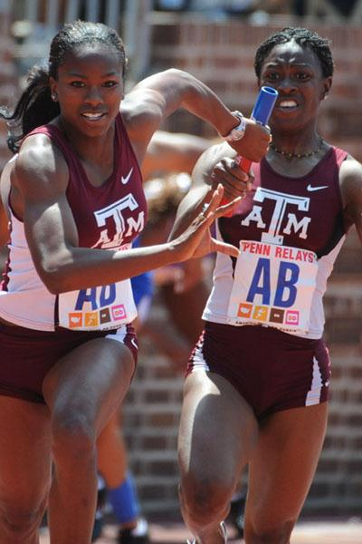 Gabby Mayo and Simone Facey of Texas A&M in 4x100m Relay qualifying (Kirby Lee)
