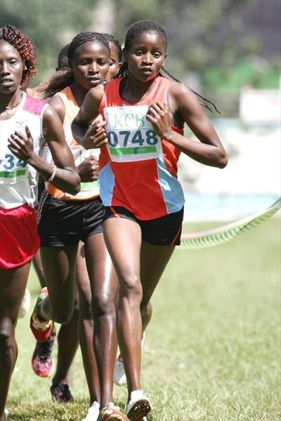 Winner Grace Nyemweno (0748) keeps in touch with the women's 8km race leaders during the KCB National Cross Country Series race at Kisii (Mohammed Amin)