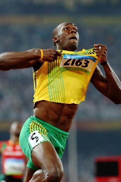 Usain Bolt celebrates his 19.30 clocking (Getty Images)