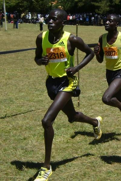 John Kemboi (2316) winner of the 8km junior men race during the Discovery Cross Country leads Abraham Bartum (2087) and Simon Cheprot (2399). (David Macharia)