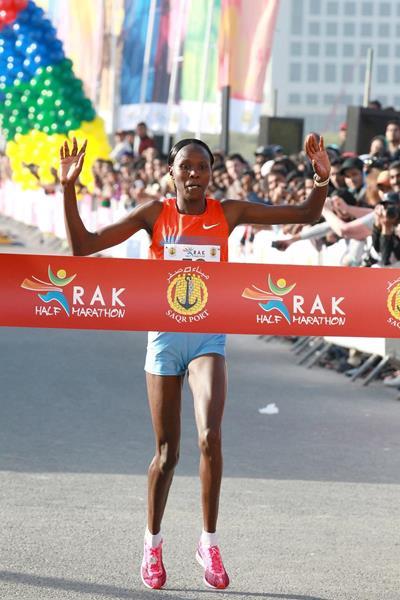 Priscah Jeptoo winning at the 2014 RAK Half Marathon (Victah Sailer / organisers)