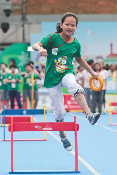 Children running the hurdles at the IAAF Kids' Athletics event in Nanjing (Getty Images)