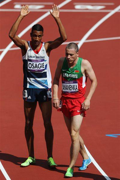 Andrew Osagie of Great Britain stands alongside Anis Ananenka of Belarus after they compete in the Men's 800m heat on Day 10 of the London 2012 Olympic Games on 06 August 2012 (Getty Images)