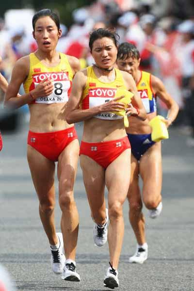 Xiaolin Zhu and Chunxiu Zhou of China compete in the Women's Marathon (Bongarts/Getty Images)