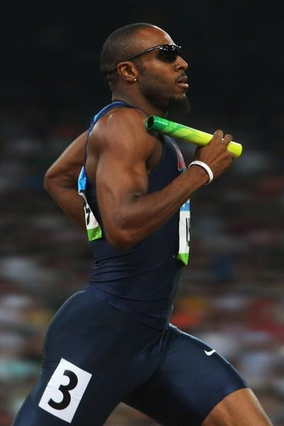Angelo Taylor safely brings the US home in the heats of the 4x400m relay (Getty Images)