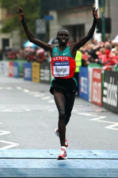 Silver medallist Bernard Kipyego celebrates as he crosses the finish line in Birmingham (Getty Images)
