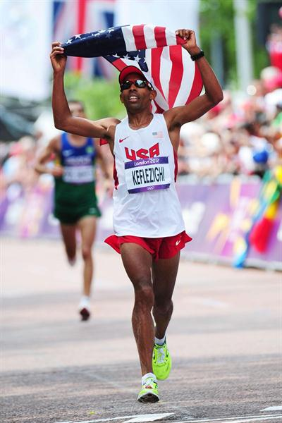 Mebrahtom Keflezighi of the United States holds the United States' national flag aloft as he approaches the finish line in the Men's Marathon  of the London 2012 Olympic Games. (Getty Images)