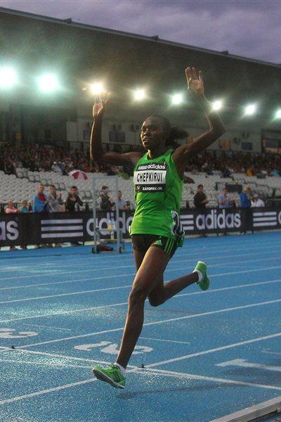 Joyce Chepkirui of Kenya celebrates as she crosses the finish line to win the Zatopek 10 Women's 10,000m during the 2011 Zatopek Classic  (Getty Images)