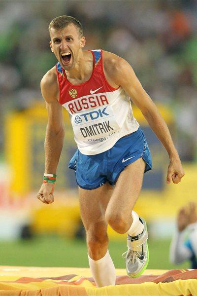 Aleksey Dmitrik of Russia celebrates his second place during the men's high jump final (Getty Images)