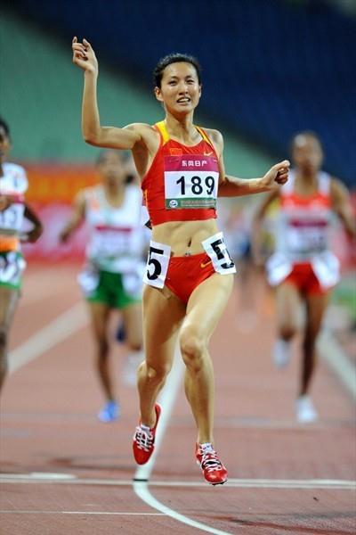 Zhou Haiyan takes the Asian 1500m title at home in Guangzhou (Jiro Mochizuki)