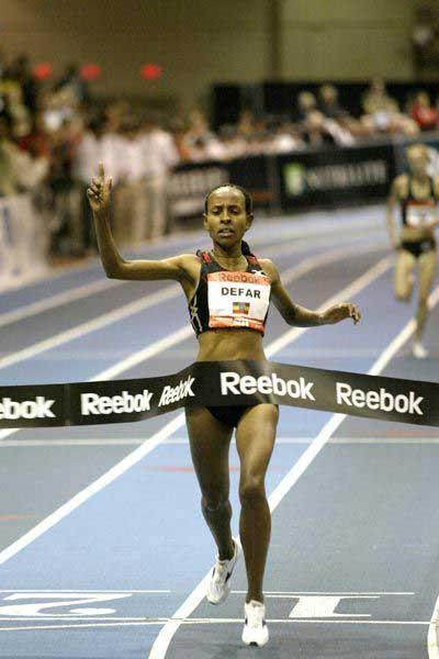 Meserat Defar crosses for a World Two Miles best in Boston (Victah Sailer)