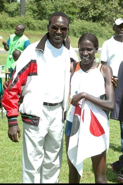 Pauline Korikwiang poses with Kenya's five times world cross country champion Paul Tergat after she won the eight kilometre women's race at the third Athletics Kenya cross country champions meeting in Meru, eastern Kenya (Elias Makori)