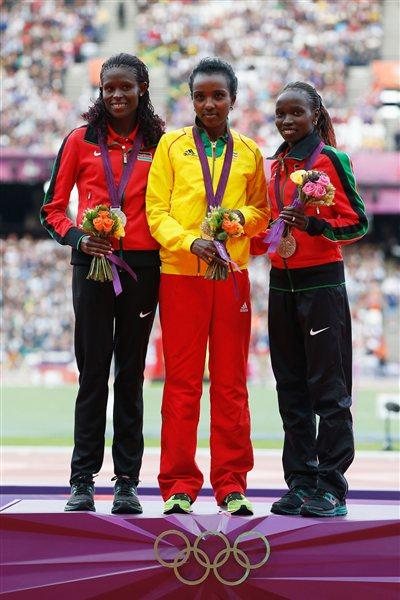 (L-R) Bronze medalist Jepkemoi Vivian Cheruiyot of Kenya, gold medalist Tirunesh Dibaba of Ethiopia and silver medalist Sally Jepkosgei Kipyego of Kenya pose on the podium during the medal ceremony for the Women's 10,000m on Day 8 of the London 2012 Olympic Games at Olympic Stadium on August 4, 2012 in London, England (Getty Images)