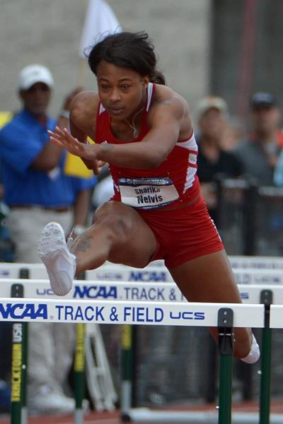 Sharika Nelvis winning the 100m hurdles at the 2014 NCAA Championships (Kirby Lee)