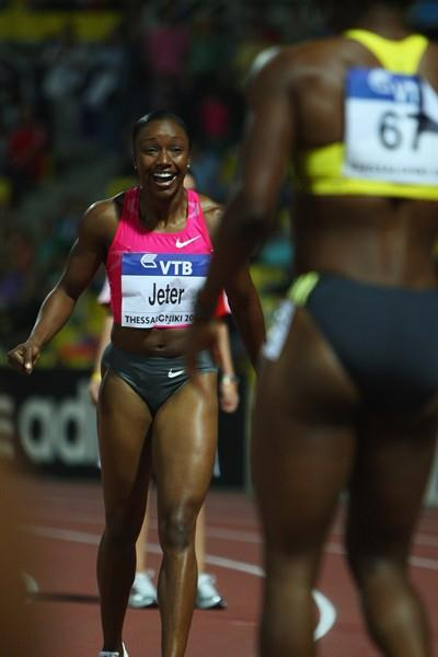 Carmelita Jeter celebrates her 10.64 victory in the women's 100m (Getty Images)