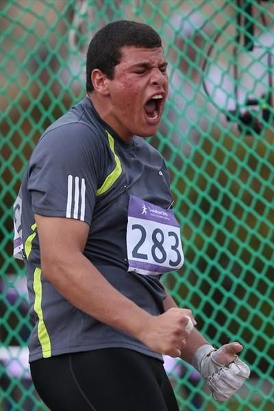 Eslam Ibrahim of Egypt reacts in the boys hammer throw qualification at the 2010 Youth Olympic Games in Singapore (XINHUA/ SYOGOC-POOL/ Meng Yongmin)