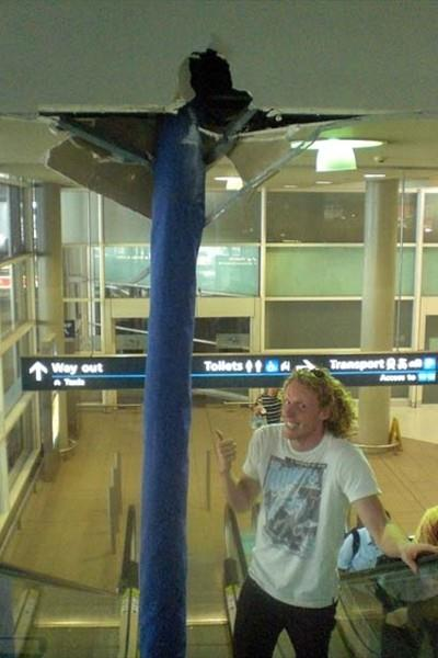 Steve Hooker with his poles literally through the roof of Sydney airport (Jacinta Boyd)