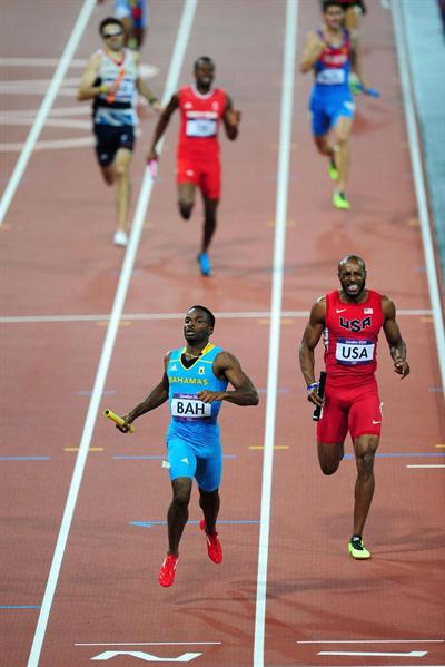 Ramon Miller (L) of the Bahamas approaches the finish line ahead of Angelo Taylor of the United States during the Men's 4 x 400m Relay Final of the London Olympic Games on 10 August 2012 (Getty Images)
