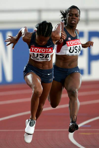 Angela Daigle and Muna Lee of the US in the women's 4x100m heats (Getty Images)