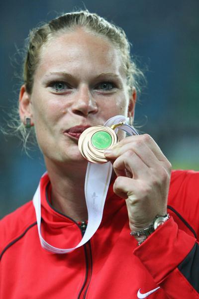 Nadine Kleinert of Germany celebrates her bronze medal in the Shot Put final (Bongarts/Getty Images)