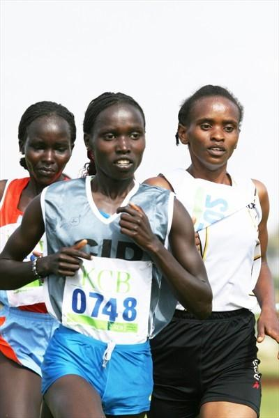 Vivian Cheruiyot (centre) competes with Pauline Njeri (right) and Anne Cheptanui in the eight-kilometre women's race at the 2009 Kenya Police National Cross Country Championships at the Ngong Racecourse in Nairobi. Cheruiyot won the race. (Elias Makori)