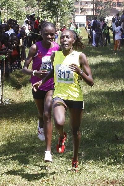 Caroline Chepkwony fights off Grace Momanyi in Kisii (Ignatius Kemboi / Ginadin Communications)