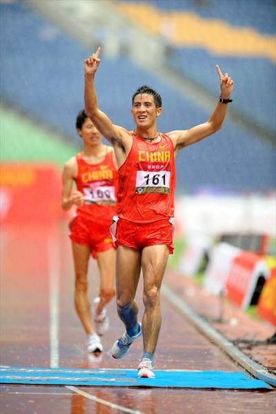A quick stroll in the rain - Li Jianbo wins the 20km (Jiro Mochizuki)