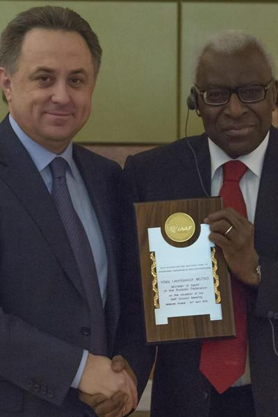 Minister of Sport of Russia Vitaly Leontiyevich Mutko receiving an IAAF Honorary Plaque from President Diack on the occasion of the opening of the IAAF Council in Moscow, 6 April (Nikolay Kondakov / LOC)