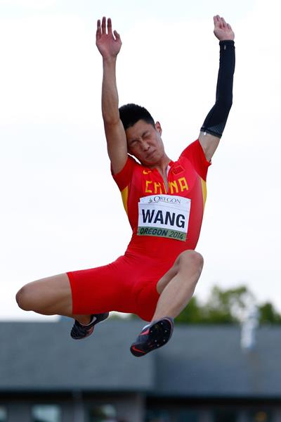 Wang Jianan on his way to gold in the long jump at the IAAF World Junior Championships, Oregon 2014 (Getty Images)