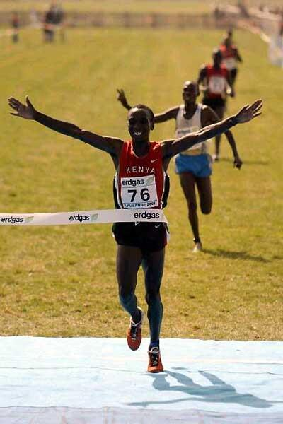 Eliud Kipchoge wins the men's junior race at the 2003 IAAF World Cross Country Championships in Lausanne (Getty Images)