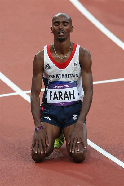 Mo Farah of Great Britain enjoys being Olympic Champion of the Men's 5000m Final  of the London 2012 Olympic Games  on August 11, 2012 (Getty Images)