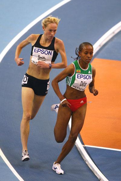 Meseret Defar holds of Kim Smith in the heats of the women's 3000m (Getty Images)