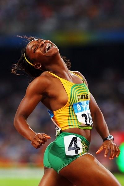 Shelly-Ann Fraser smiles as she crosses the 100m finish line in first place (Getty Images)