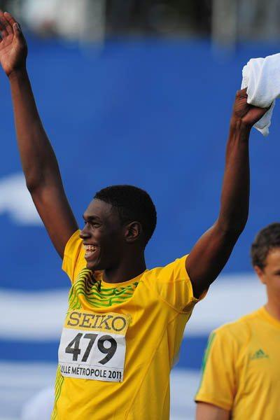 Fedrick Dacres of Jamaica celebrates winning the World Youth Discus Throw gold medal in Lille (Getty Images)