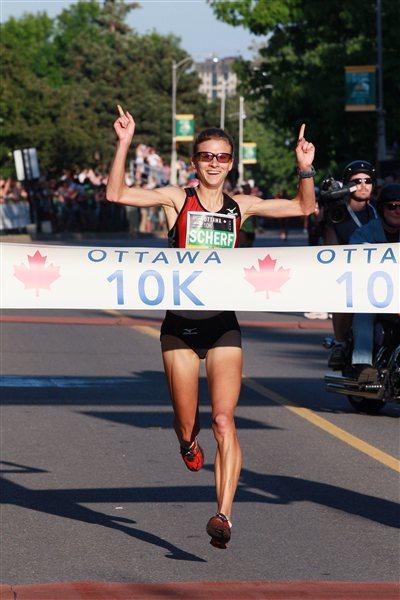 All smiles - Lindsey Scherf winning the Ottawa 10K (Victah Sailer)