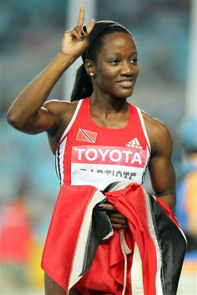 Kelly-Ann Baptiste of Trinidad and Tobago celebrates after finishing third in the women's 100 metres final  (Getty Images)