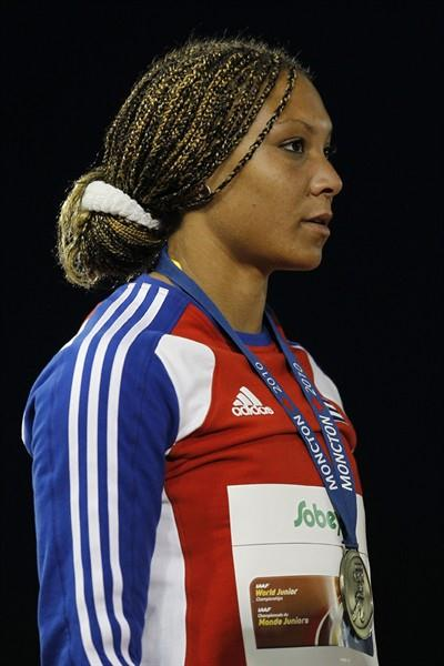 Yaime Pérez of Cuba receives her gold medal after winning the Discus with a 56.01m throw (Getty Images)